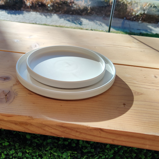 ivory stone dinner plates on natural wood hedge bar top